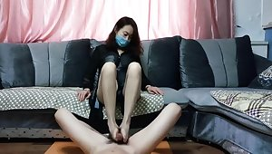 Chinese mature woman in nylon stockings and sexy underwear in a passionate footjob scene