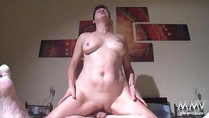 Chubby German mature babe rides her sleeping hubby