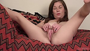 Nasty mature Olivia Johnson posing and masturbating solo in lingerie