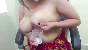 Indian housewife with huge tits squeezing milk in glass