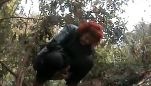 Mature redhead pee in the forest